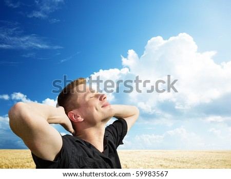 young man rest on wheat field