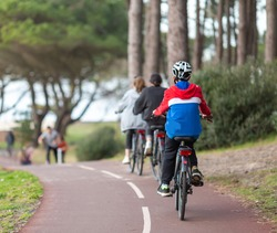 young man riding a bicycle on the bike path