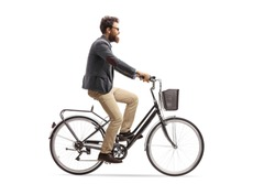 Young man riding a bike isolated on white background