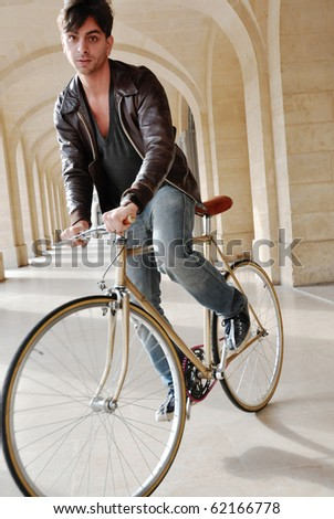Young man riding a fixie - stock photo