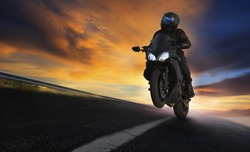 young man riding motorcycle on asphalt highways road with professional extreme biking skill use for sport racing and people vacation activities