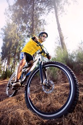 young man riding mountain bike mtb in jungle track use for sport  extreme adventure  healthy  and holiday activities life style