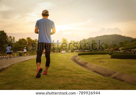 young man running at sunset time #789926944