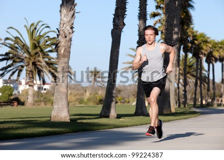 Young man running by the beach