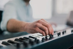 young man's hands playing keyboard piano, composing music , music record concep, art, song composition, dj