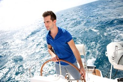 Young man sailing in caribbean sea