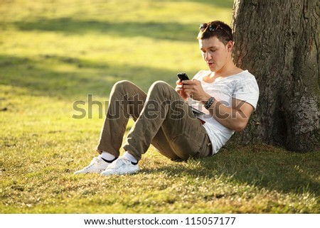 young man sending text to his girlfriend