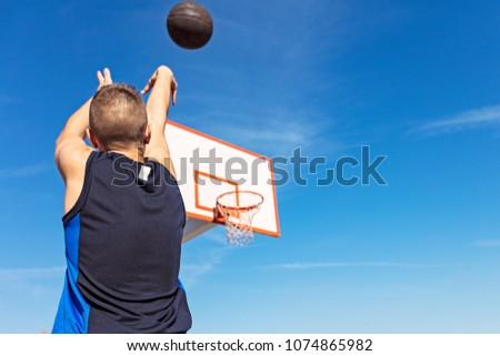 Young man shooting free throws from the foul line