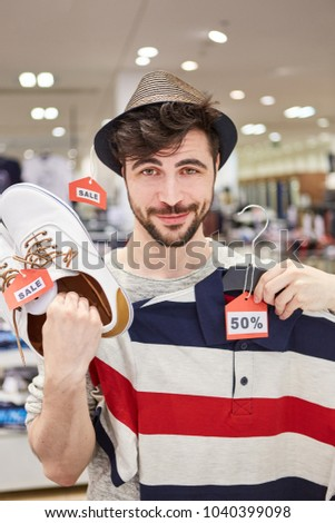 Young man shopping finds fashion at a promotional price in the fashion shop