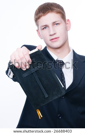 Young man showing Bible, selective focus