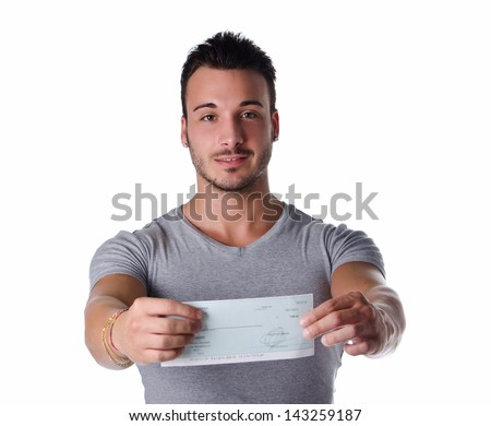 Young man showing check (cheque) in his hands, looking at camera