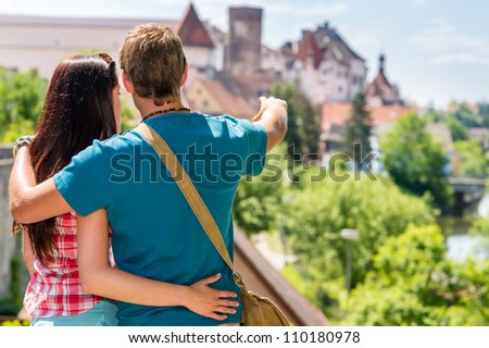 Young man showing woman the castle architecture vacation travel love