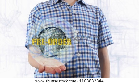 Young man shows a hologram of the planet Earth and text Pre order. Boy with future technology 3d projection on a modern white digital background