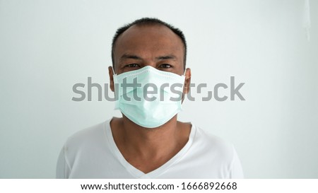 Young man sick and wearing mask on face
