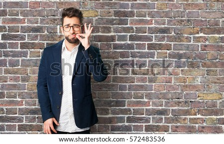 young man silence gesture #572483536