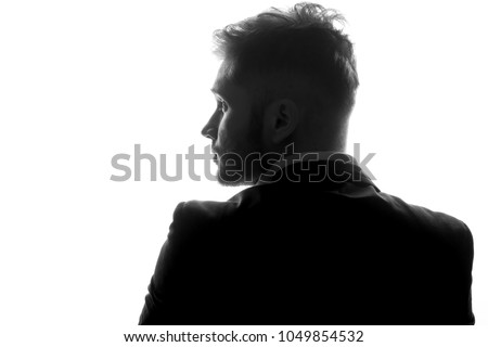 Young man silhouette in suit profile on a white isolated background #1049854532