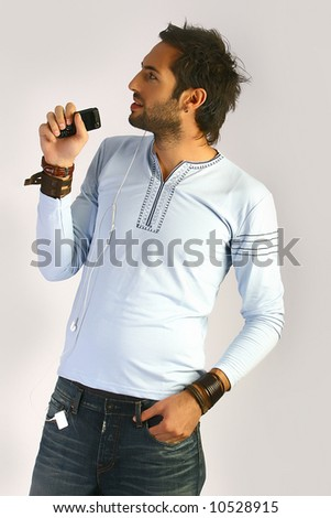 young man sing on a cellphone - stock photo