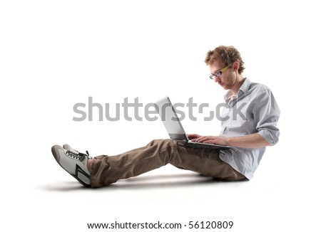 Young man sitting and using a laptop