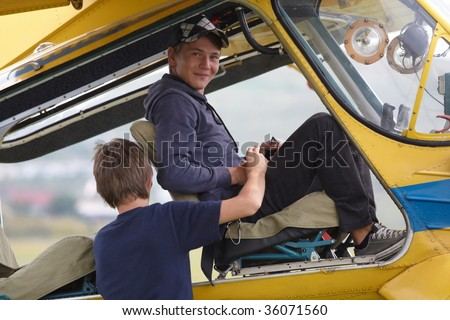 Young man sitting in a plane for a flight lesson