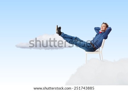 Young man sitting in chair with legs up and relaxing #251743885