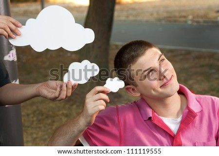 Young man sitting on a bench and thinks