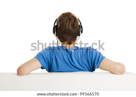 Young man sitting on the couch and listen music, isolated on white