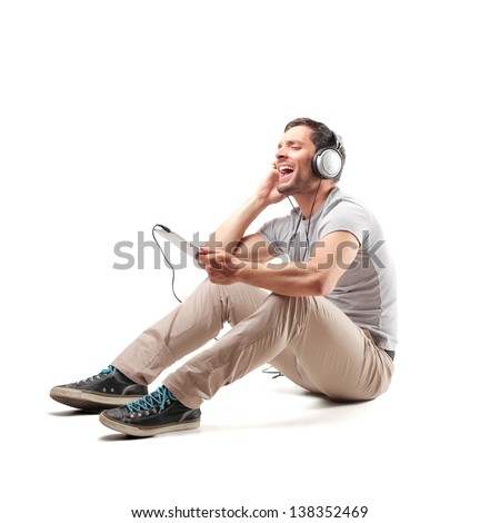 young man sitting on the floor listening to music stock photo