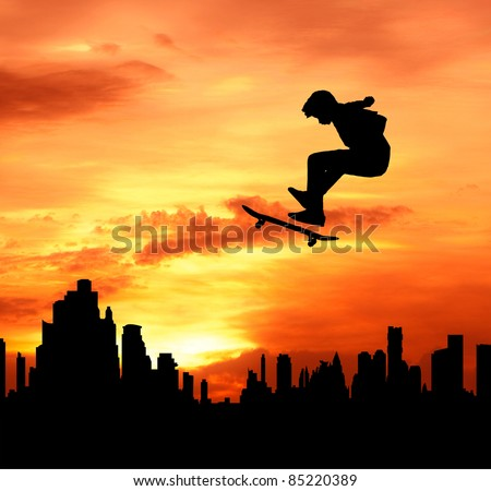 young man skateboarder jumping over the city during sunset silhouetted, extreme sport