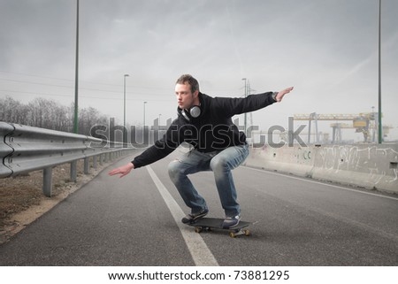 Young man skating on a street