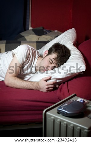 Young man sleeping comfortably in his bed