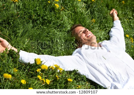 Young man sleeping on the green grass