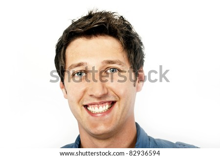 young man smiling in blue shirt