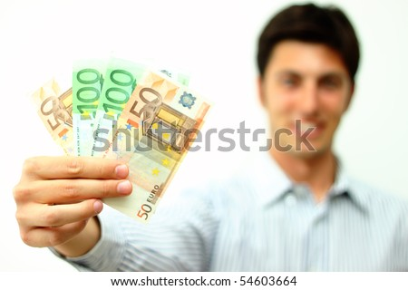 Young man smiling with banknotes in his hand