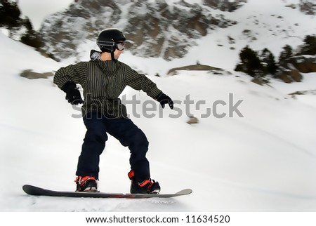 young man snowboarding in the moutain off track - stock photo
