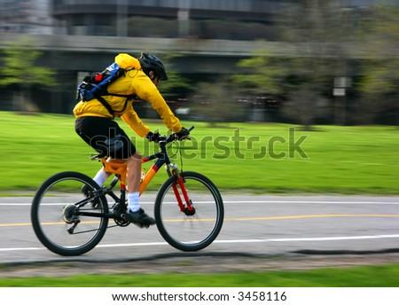 Young man speeding on a mountain bike