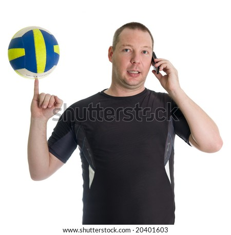 Young man spinning volley ball on the finger whilst calling. Isolated over white