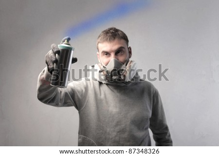 Young man spraying paint
