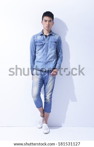 young man standing full length isolated on white background