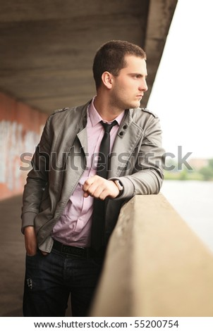 young man standing near handhold