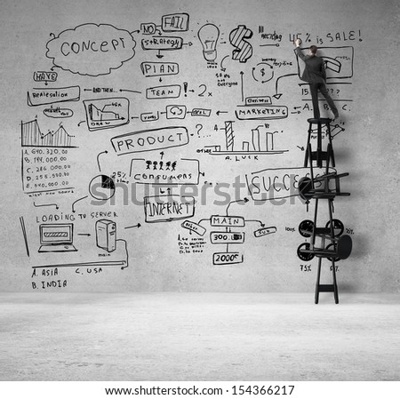 young man standing on stool and drawing business concept