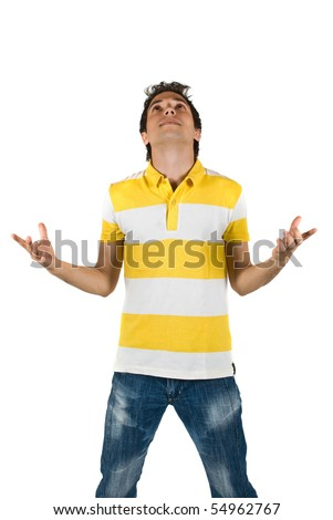 Young man standing with open hands  and looking up ,meditating isolated on white background