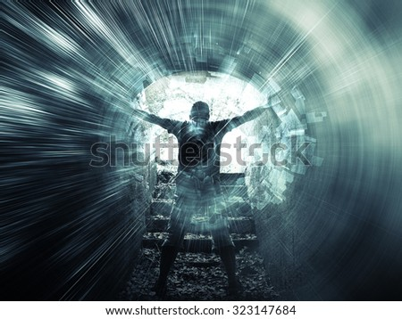 Young man stands in dark blue tunnel with glowing end and abstract lights structures #323147684