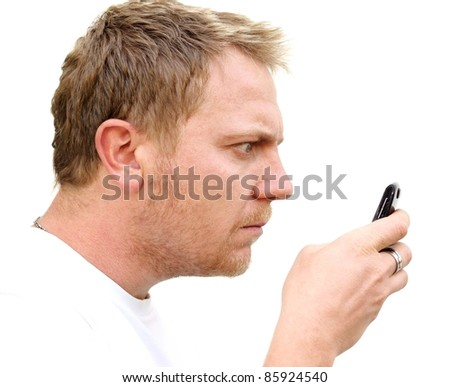 Young man stare at his mobile phone.
