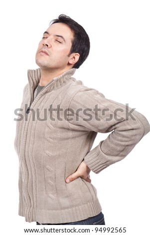 young man suffering from back pain - stock photo