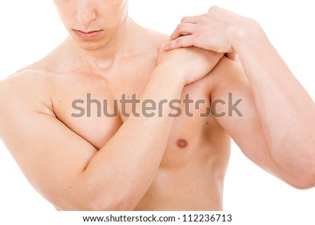 Young man suffering from shoulder pain, isolated on white - stock photo