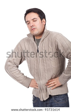 young man suffering from stomach ache - stock photo