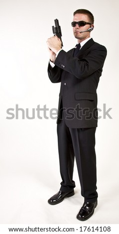Young man suggesting a secret service agent or secret policeman with armed a gun. - stock photo