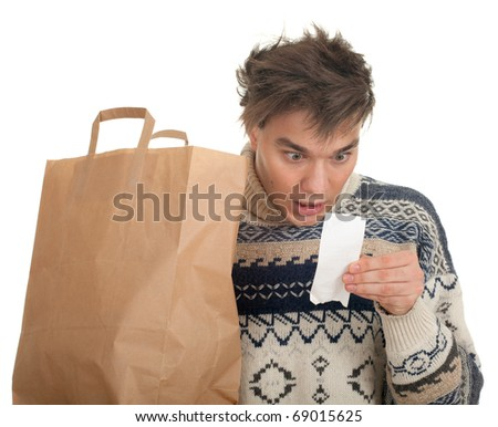 young man surprised expression looking at store receipt