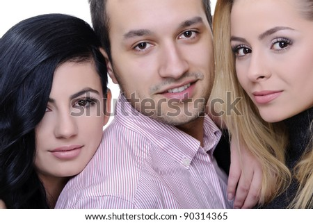 young man surrounded by two girls; friends portrait