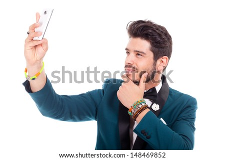 young man takes pictures with cellphone